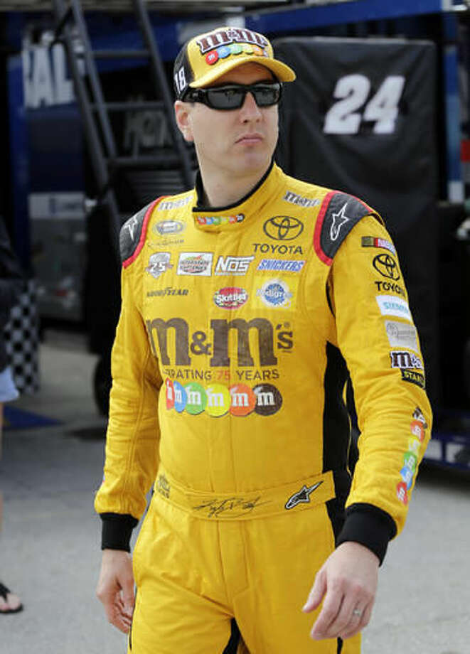 Kyle Busch walks in the garage area before the NASCAR Sprint Cup Series auto practice, Saturday, Nov. 19, 2016, in Homestead, Fla. (AP Photo/Terry Renna)