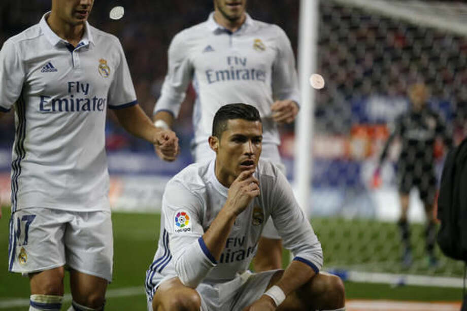 Real Madrid's Cristiano Ronaldo poses for a television camera after scoring his side's second goal against Atletico Madrid during a Spanish La Liga soccer match between Real Madrid and Atletico Madrid at the Vicente Calderon stadium in Madrid, Saturday, Nov. 19, 2016. Ronaldo scored a hat trick in Real Madrid 3-0 victory. (AP Photo/Francisco Seco)