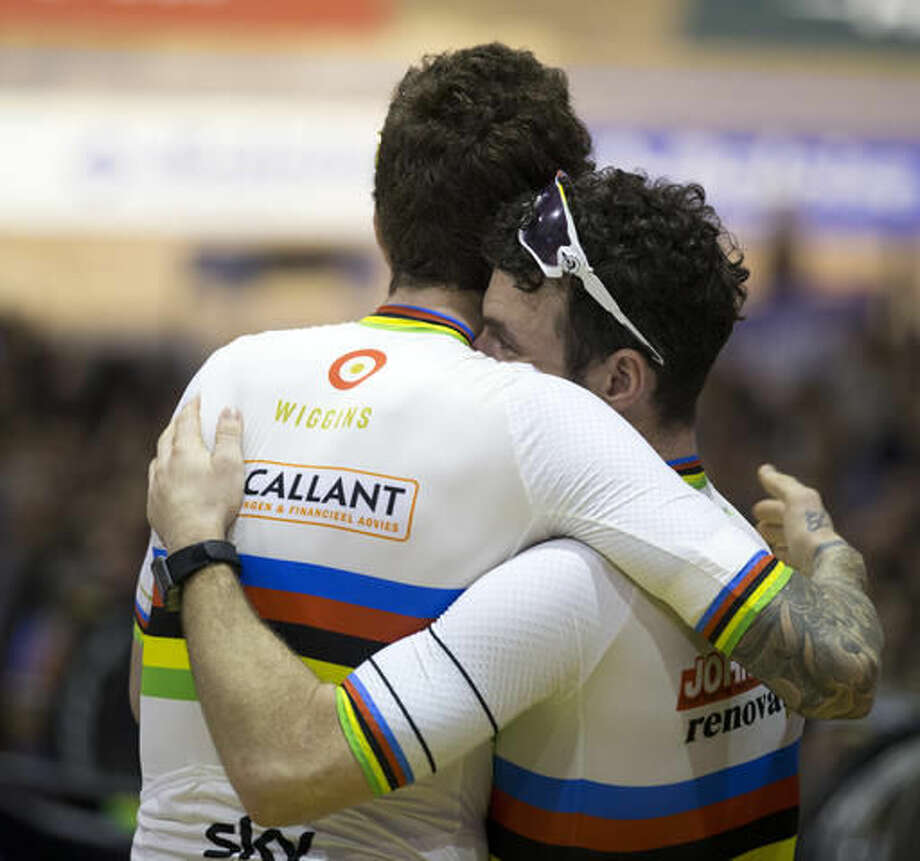 Britain's Mark Cavendish hugs former Tour de France winner and Olympic Gold medallist Britain's Bradley Wiggins after they won the six day race at 't Kuipke velodrome in Ghent, Belgium, Sunday, Nov. 20, 2016. The Ghent Six Day event was the first bike race that his father took him to as a child, long before he would become the most decorated Olympian in British history. (AP Photo/Peter Dejong)