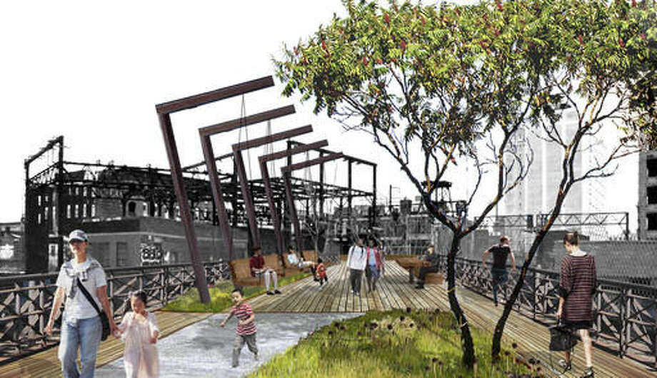 This rendering provided by Studio Bryan Hanes depicts park visitors using a landscaped elevated walkway planned as the replacement for abandoned railroad tracks in downtown Philadelphia. After over a decade of planning, Philadelphia is scheduled to start construction on the Viaduct Rail Park, transforming the rusting, overgrown and abandoned rail line into an elevated park. It will join the likes of New York City's High Line, and officials say it will transform the way Philadelphians move through the city. (Studio Bryan Hanes via AP)