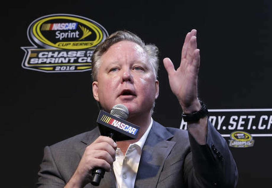 NASCAR CEO and Chairman, Brian France talks to reporters during a news conference before the NASCAR Sprint Cup auto race practice Sunday, Nov. 20, 2016, in Homestead, Fla. (AP Photo/Alan Diaz)