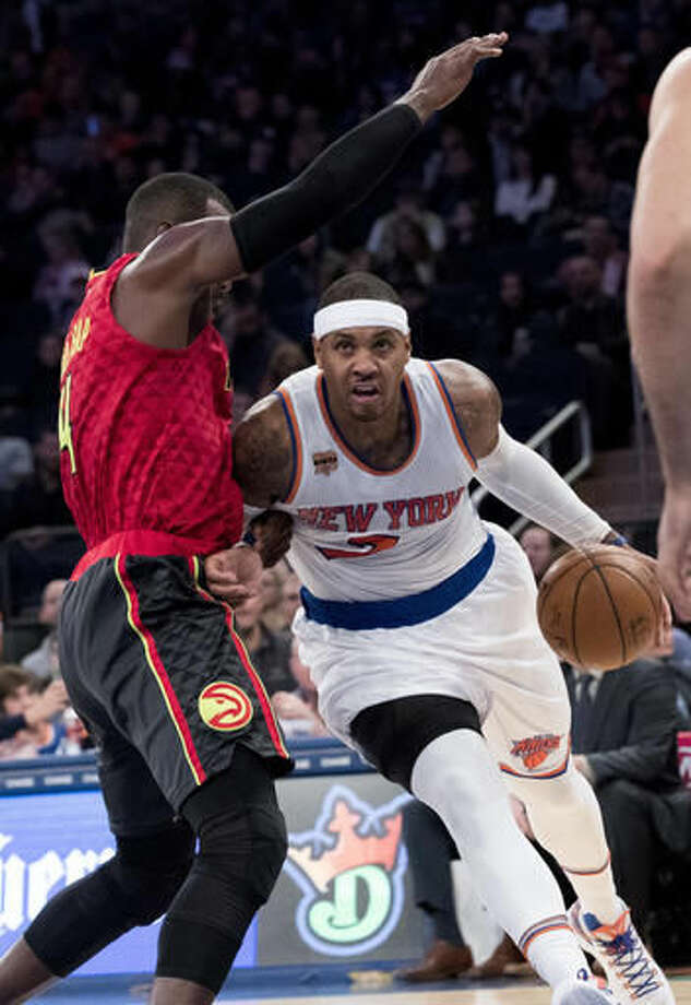 New York Knicks forward Carmelo Anthony, right, drives to the basket agains tAtlanta Hawks forward Paul Millsap during the first half of an NBA basketball game, Sunday, Nov. 20, 2016, at Madison Square Garden in New York. (AP Photo/Mary Altaffer)