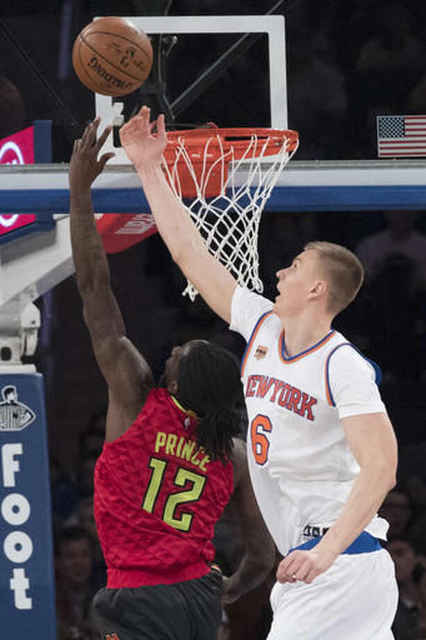Atlanta Hawks forward Taurean Prince (12) goes to the basket against New York Knicks forward Kristaps Porzingis (6) during the first half of an NBA basketball game, Sunday, Nov. 20, 2016, at Madison Square Garden in New York. (AP Photo/Mary Altaffer)