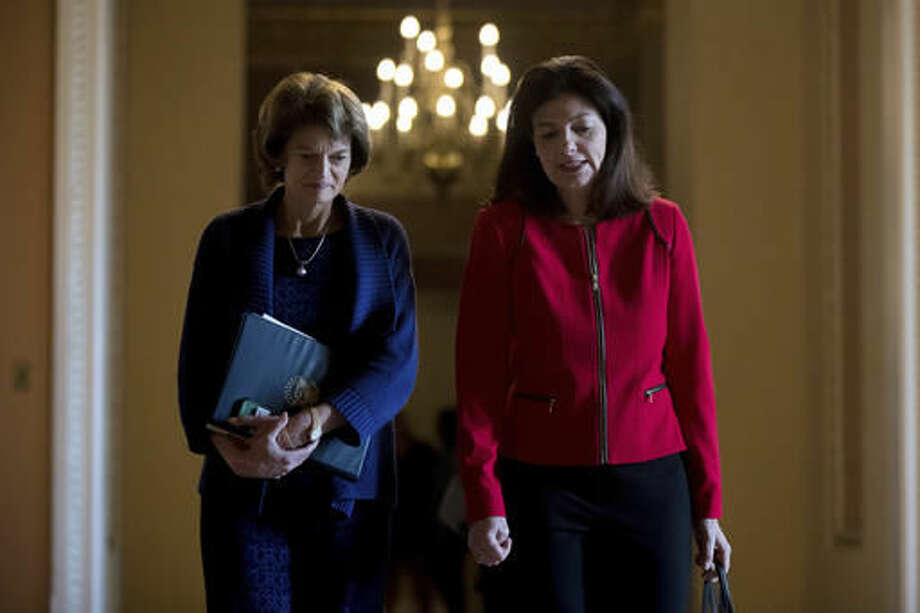 Sen. Lisa Murkowski, R-Alaska, left, and Sen. Kelly Ayotte, R-N.H. leave a Senate Republican conference leadership election meeting on Capitol Hill in Washington, Wednesday, Nov. 16, 2016, after Senate Republicans re-elected Senate Majority Leader Mitch McConnell of Ky. to be majority leader for the upcoming 115th Congress. (AP Photo/Andrew Harnik)