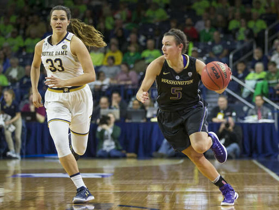 Washington's Natalie Romeo (5) drives downcourt next to Notre Dame's Kathryn Westbeld (33) during the first half of an NCAA college basketball game Sunday, Nov. 20, 2016, in South Bend, Ind. (AP Photo/Robert Franklin)