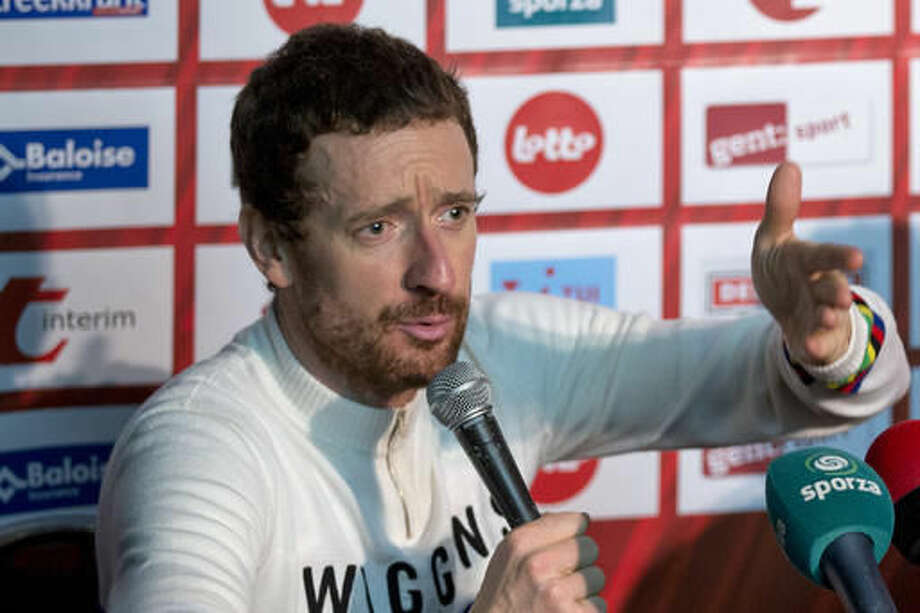Former Tour de France winner and Olympic Gold medallist Britain's Bradley Wiggins annswers questions of journalists after the six day race at 't Kuipke velodrome in Ghent, Belgium, Sunday, Nov. 20, 2016. The Ghent Six Day event was the first bike race that his father took him to as a child, long before he would become the most decorated Olympian in British history. (AP Photo/Peter Dejong)