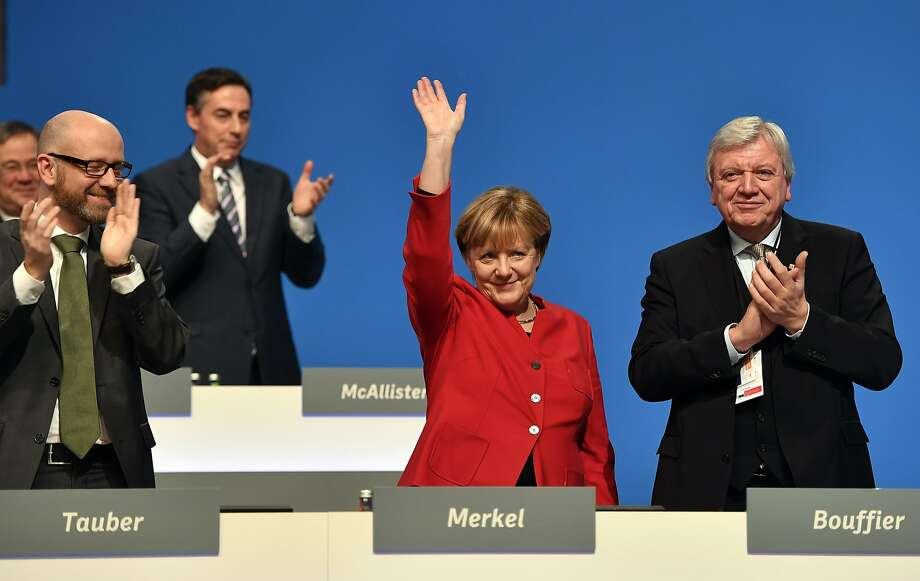 Chancellor Angela Merkel waves to supporters at a meeting of the Christian Democratic Union in Essen. Photo: Martin Meissner, Associated Press