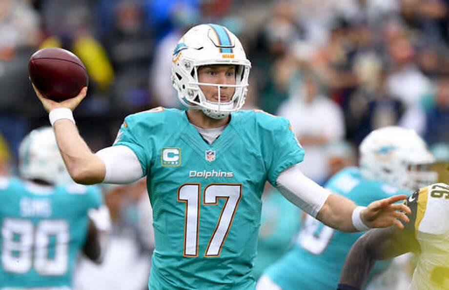 Miami Dolphins quarterback Ryan Tannehill passes against the Los Angeles Rams during the the first half of an NFL football game Sunday, Nov. 20, 2016, in Los Angeles. (AP Photo/Mark J. Terrill)