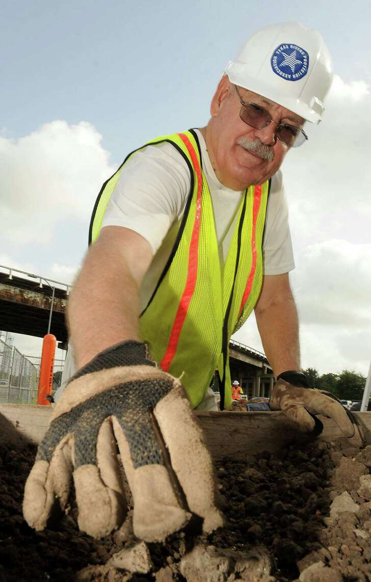 Houston Archeological Society Vice President Louis Aulbach will review on Dec. 18 this year's activities including excavations at Frost Town. Above, he sifts through dirt looking for artifacts during a dig at the site of Frost Town at 512 McKee downtown in July.