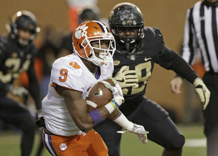Clemson's Wayne Gallman (9) runs past Wake Forest's Willie Yarbary (48) during the second half of an NCAA college football game in Winston-Salem, N.C., Saturday, Nov. 19, 2016. Clemson won 35-13. (AP Photo/Chuck Burton)