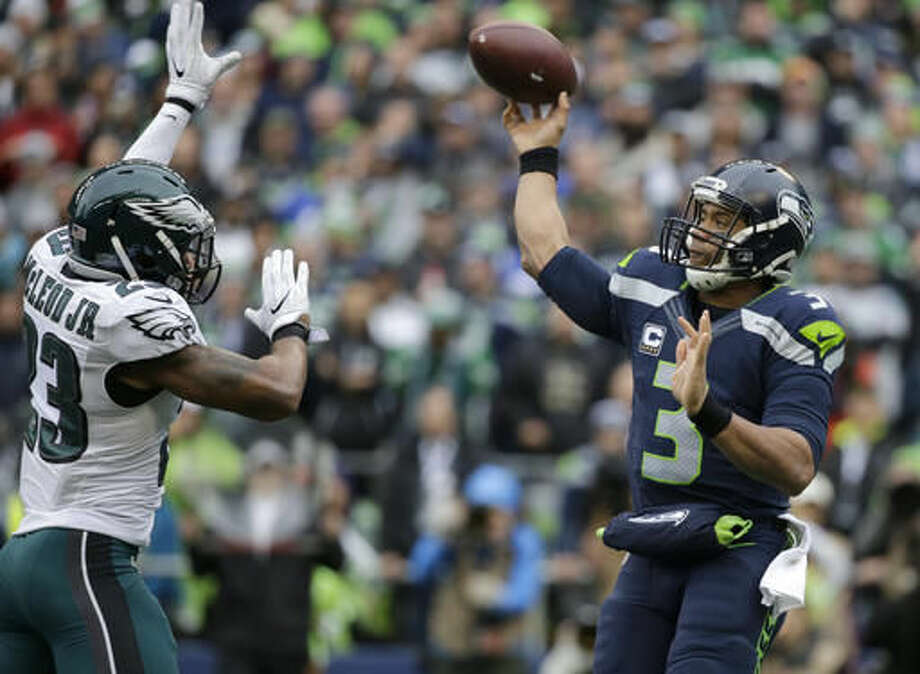 Seattle Seahawks quarterback Russell Wilson (3) passes against Philadelphia Eagles free safety Rodney McLeod (23) in the first half of an NFL football game, Sunday, Nov. 20, 2016, in Seattle. (AP Photo/John Froschauer)