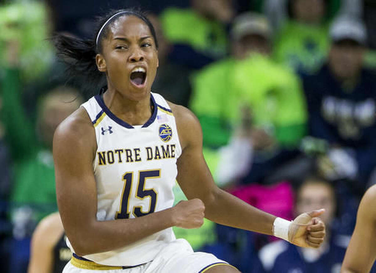 Notre Dame's Lindsay Allen (15) celebrates after forcing an offensive foul against Washington during the second half of Notre Dame's 71-60 win in an NCAA college basketball game Sunday, Nov. 20, 2016, in South Bend, Ind. (AP Photo/Robert Franklin)