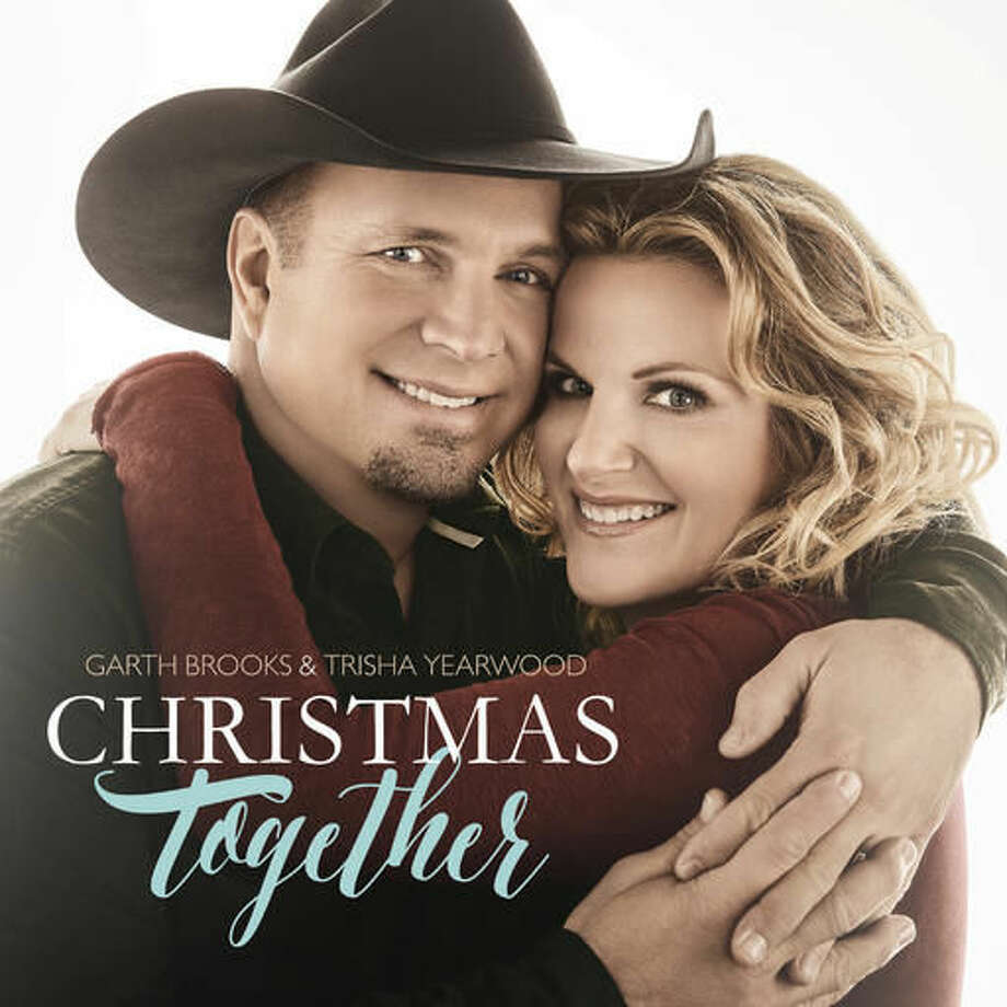 """This image released by Pearl Records shows """"Christmas Together,"""" by Garth Brooks and Trisha Yearwood. (Pearl Records via AP)"""