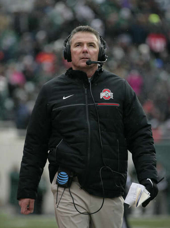 Ohio State coach Urban Meyer walks the sideline during the fourth quarter of an NCAA college football game against Michigan State, Saturday, Nov. 19, 2016, in East Lansing, Mich. Ohio State won 17-16. (AP Photo/Al Goldis)