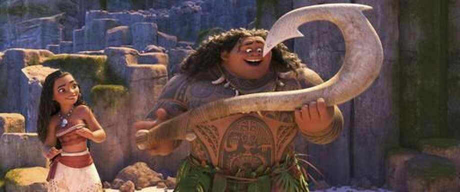 "This image released by Disney shows characters Maui, voiced by Dwayne Johnson, right, and Moana, voiced by Auli'i Cravalho, in a scene from the animated film, ""Moana."" (Disney via AP)"