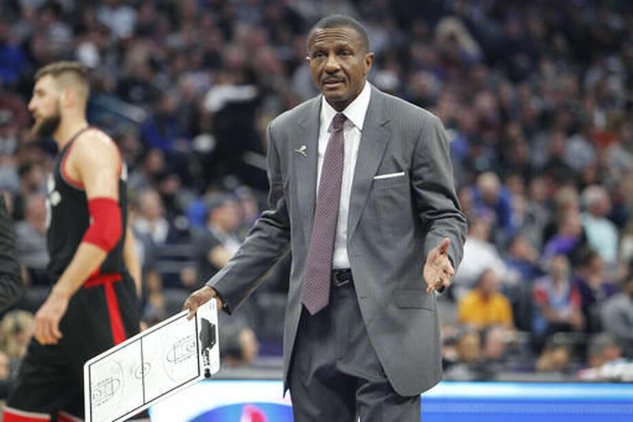 Toronto Raptors head coach Dwane Casey talks with an official during a time out against the Sacramento Kings during the first half of an NBA basketball game in Sacramento, Calif., Sunday, Nov. 20, 2016. (AP Photo/Steve Yeater)