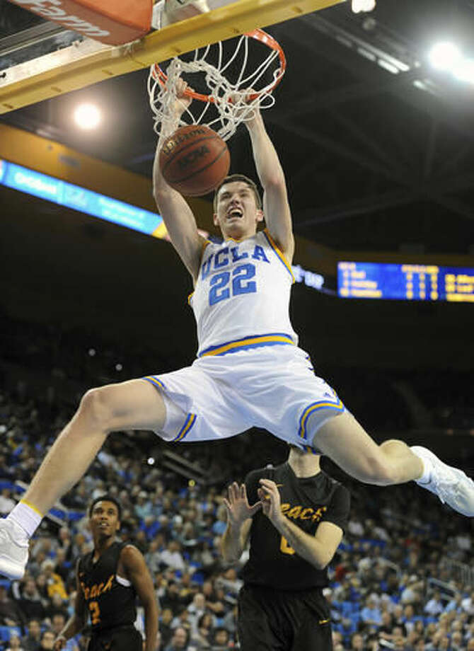 UCLA's T.J. Leaf (22) dunks against Long Beach State during the first half of an NCAA college basketball game in Los Angeles, Sunday, Nov. 20, 2016. (AP Photo/Michael Owen Baker)