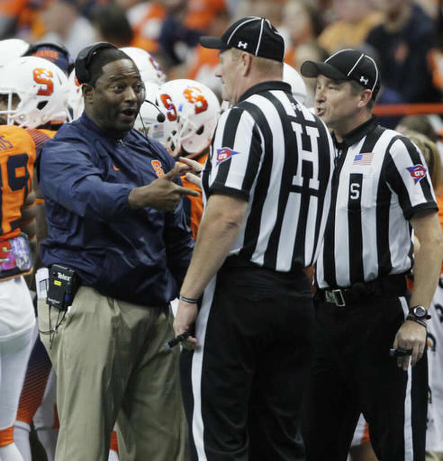 Syracuse head coach Dino Babers, left, yells at the officials in the second quarter of an NCAA college football game against Florida State in Syracuse, N.Y., Saturday, Nov. 19, 2016. Florida State won 45-14. (AP Photo/Nick Lisi)