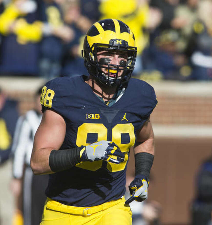 FILE - In this Oct. 22, 2016, file photo, Michigan tight end Jake Butt (88) celebrates after catching a touchdown in the first quarter of an NCAA college football game against Illinois, at Michigan Stadium in Ann Arbor, Mich. Ohio State has dominated Michigan, winning four straight and 11 of 12 to diminish intrigue in one of the greatest rivalries in sports. The third-ranked Wolverines have a chance to change the conversation Saturday against the second-ranked Buckeyes in the Horseshoe, where they haven't won since 2000. (AP Photo/Tony Ding, File)