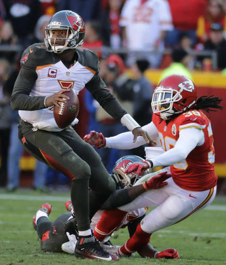 Tampa Bay Buccaneers quarterback Jameis Winston (3) looks for a receiver as Kansas City Chiefs defensive back Ron Parker (38) is tackled by running back Peyton Barber (43) during the second half of an NFL football game in Kansas City, Mo., Sunday, Nov. 20, 2016. (AP Photo/Charlie Riedel)