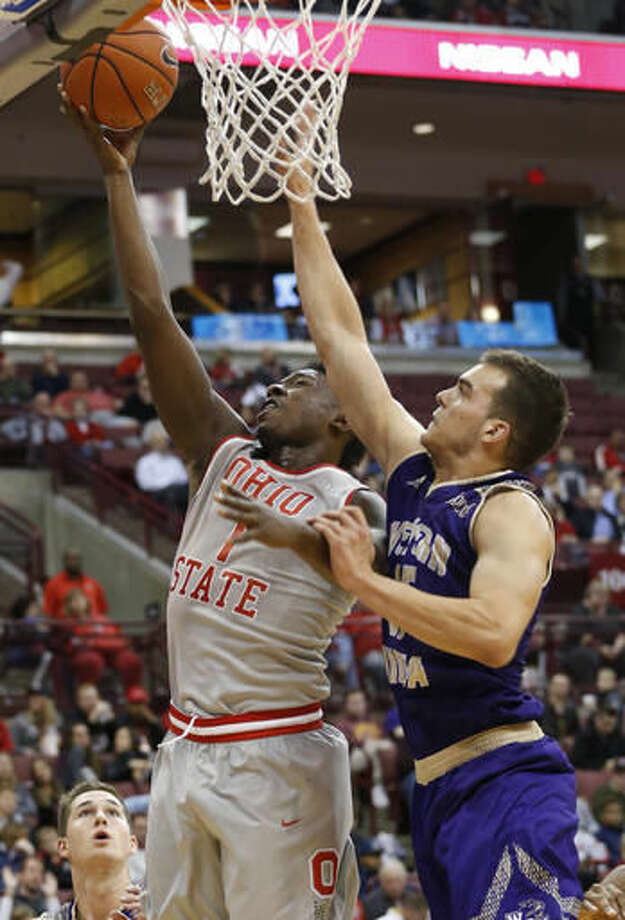 Ohio State's Jai'Sean Tate, left, takes a shot as Western Carolina's Yalim Olcay defends during the second half of an NCAA college basketball game Monday, Nov. 21, 2016, in Columbus, Ohio. Ohio State defeated Western Carolina 66-38. (AP Photo/Jay LaPrete)