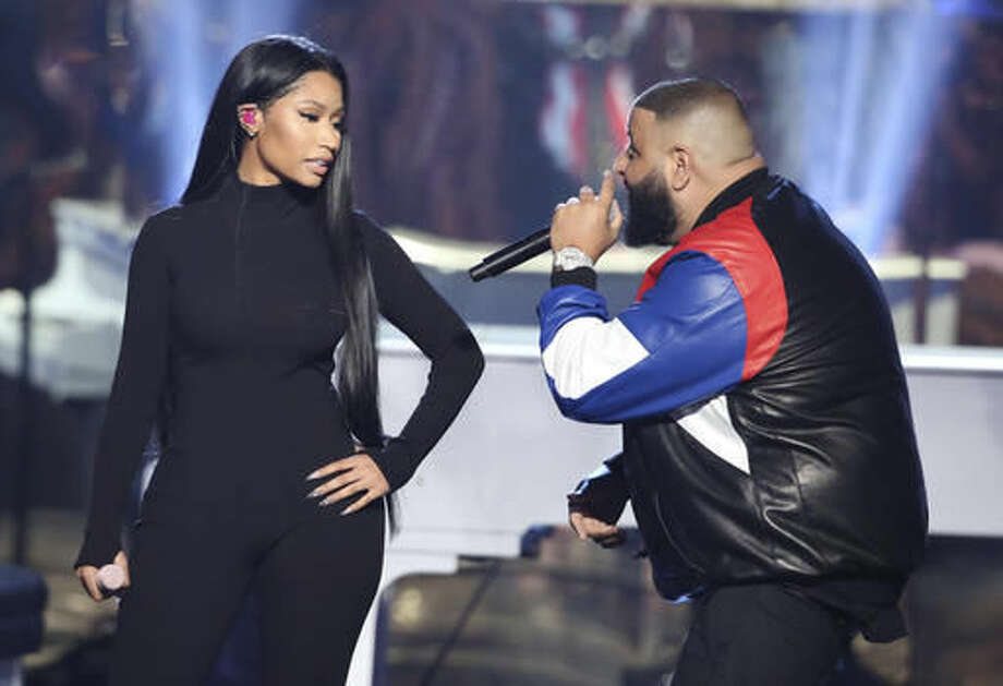 "Nicki Minaj, left, and DJ Khaled perform ""Do You Mind"" at the American Music Awards at the Microsoft Theater on Sunday, Nov. 20, 2016, in Los Angeles. (Photo by Matt Sayles/Invision/AP)"