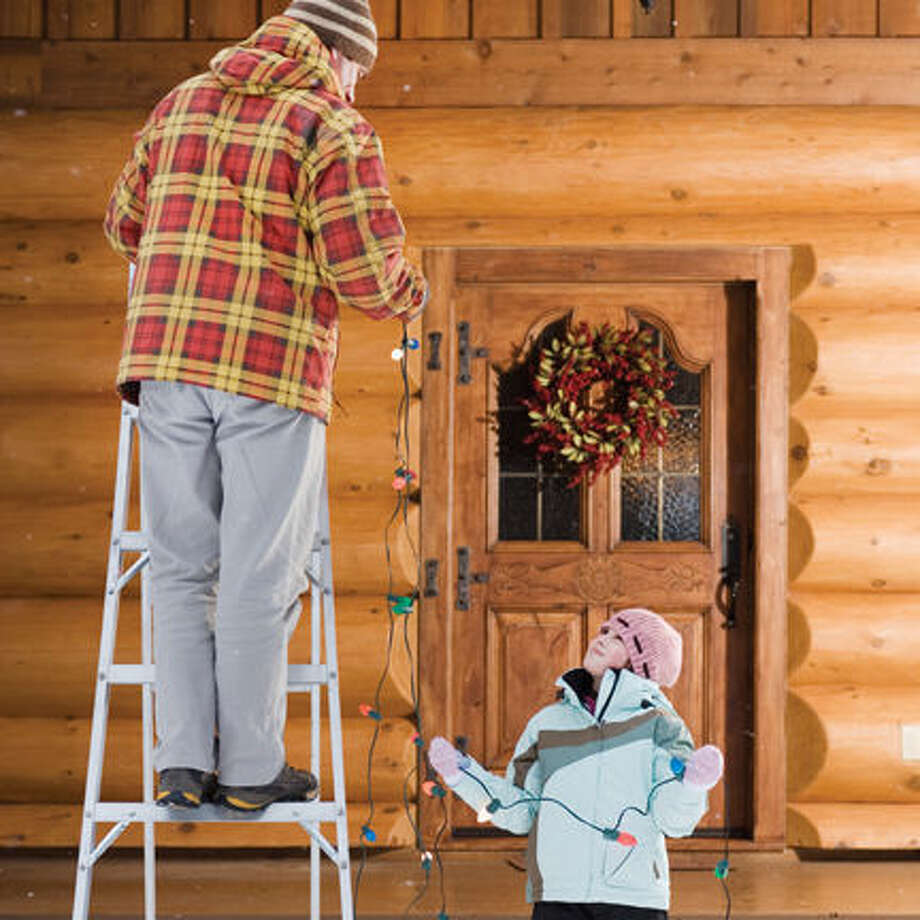 Father and Daughter Decorating House