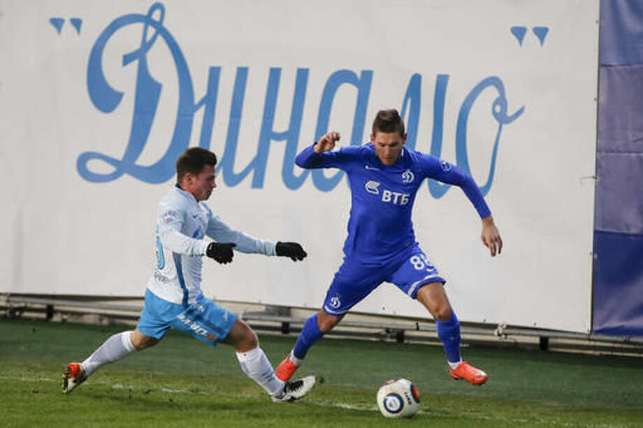 In this photo taken on Saturday, Nov. 19, 2016, Dynamo's Alexander Tashayev, right, battles for the ball with Zenit-2's Cyrill Costin during the Russian Championship soccer match between Dynamo Moscow and Zenit St.Petersburg's reserve team in Moscow, Russia. It's been the team of KGB spies, the legendary goalkeeper Lev Yashin and Putin-era Russian state capitalists. Despite its rich history, though, Dynamo Moscow is in deep trouble. (AP Photo/Pavel Golovkin)