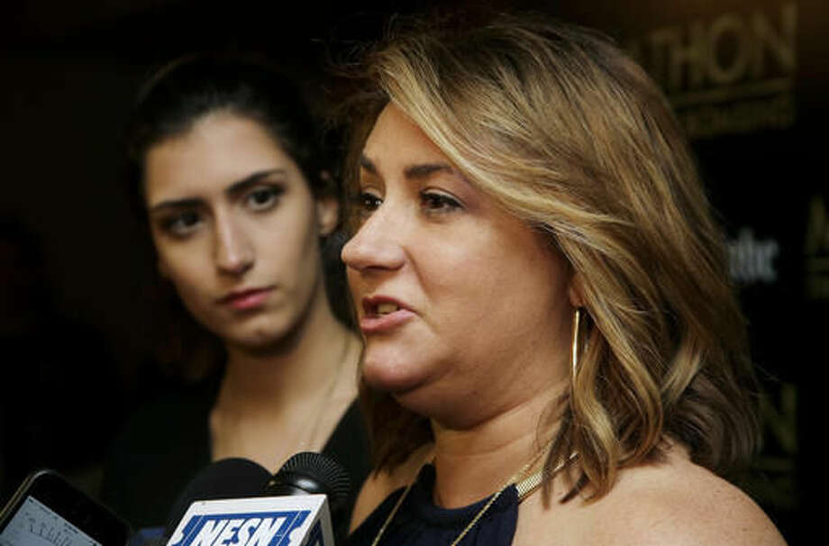 """In this Tuesday, Nov. 15, 2016 photo Boston Marathon bombing survivors Sydney Corcoran, left, and her mother Celeste Corcoran, right, take questions from reporters as they arrive at an opening for the film """"Marathon: The Patriot's Day Bombing,"""" in Boston. The new documentary about the 2013 Boston Marathon bombings chronicles the long road to recovery for many of the survivors. (AP Photo/Steven Senne)"""