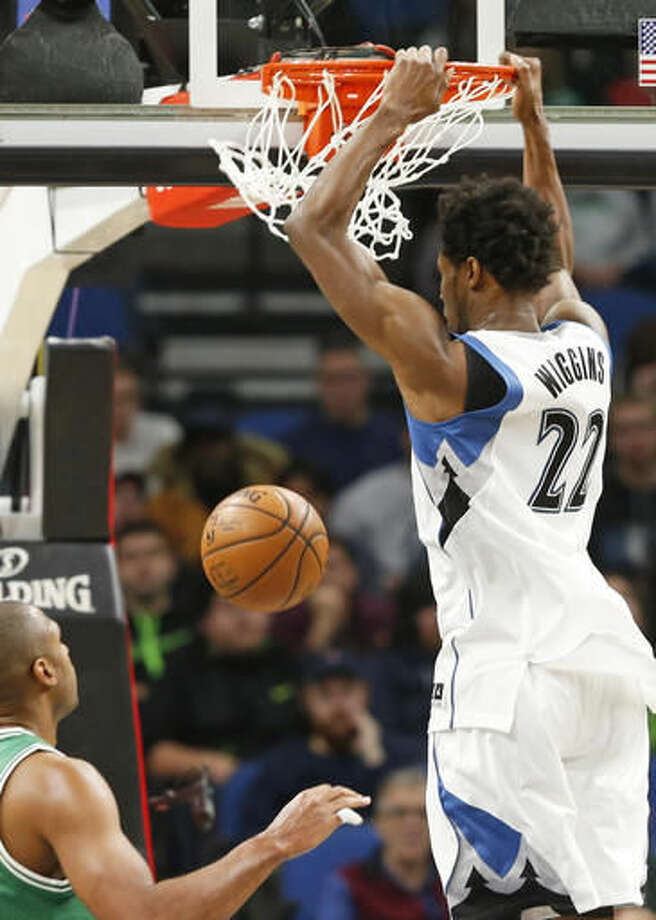 Minnesota Timberwolves' Andrew Wiggins dunks against the Boston Celtics in the first quarter of an NBA basketball game Monday, Nov. 21, 2016, in Minneapolis. (AP Photo/Jim Mone)