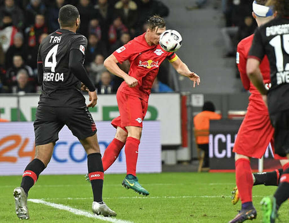 Leipzig's Willi Orban scores the winning goal with his head during the German Bundesliga soccer match between Bayer Leverkusen and RB Leipzig in Leverkusen, Germany, Friday, Nov. 18, 2016. RB Leipzig won the match with 3-2 and are the new leaders of the Bundesliga table. (AP Photo/Martin Meissner)