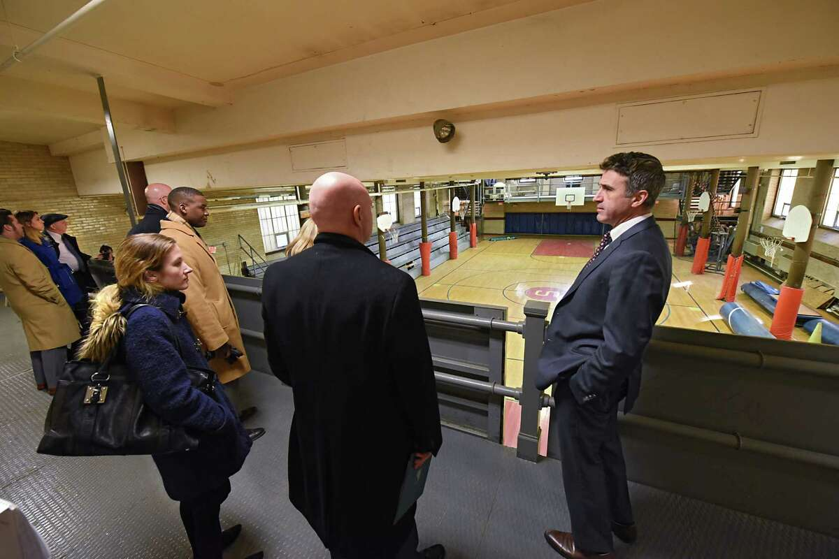 John Giarrusso, associate vice president facilities management at the University at Albany, right, gives a tour of the Schuyler Building which is the future home of the UniversityOs College of Engineering and Applied Sciences (CEAS) on Tuesday, Dec. 6, 2016 in Albany, N.Y. Originally serving as Albany High School from 1913-1972, the Schuyler Building is located at UAlbany's downtown campus. (Lori Van Buren / Times Union)