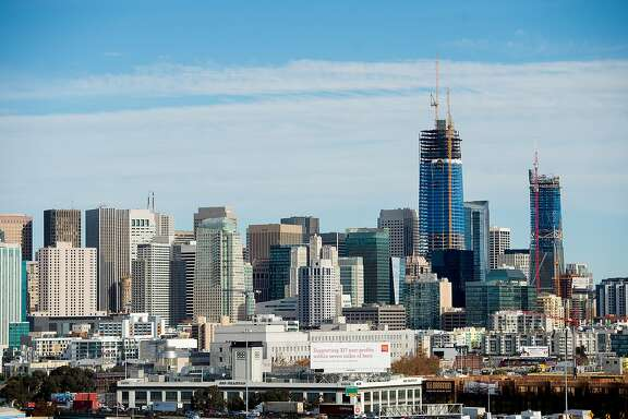 The Salesforce Tower, currently under construction, rises above San Francisco's skyline on Tuesday, Dec. 6, 2016.
