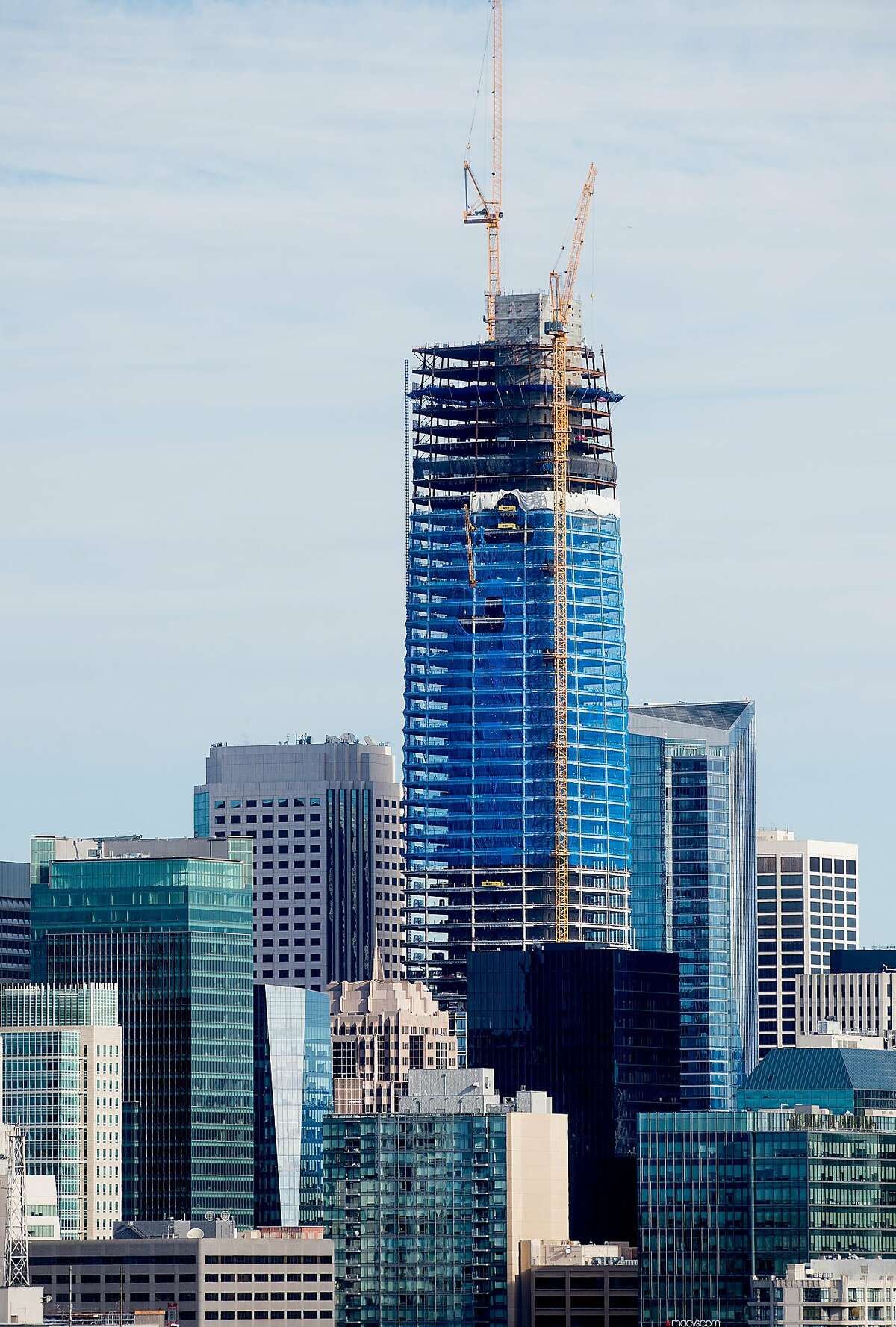 The Salesforce Tower, currently under construction, rises above surrounding buildings on Tuesday, Dec. 6, 2016, in San Francisco.