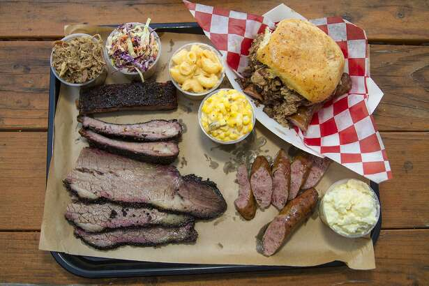 The barbecue experience at B-Daddy's Barbeque includes brisket, ribs, sausage, the Big Daddy sandwich, pulled pork and sides of chipotle cole slaw, jalapeño creamed corn, mac and cheese, and potato salad.