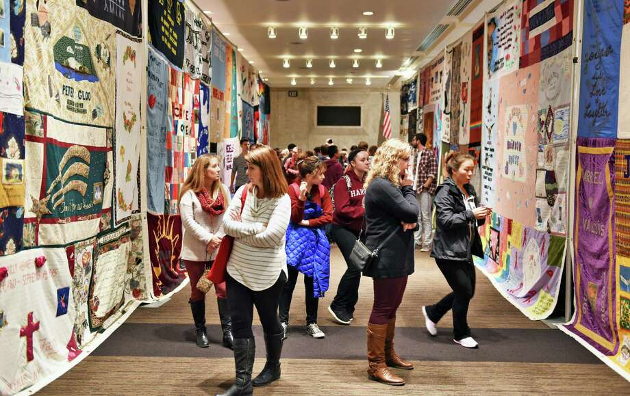 Attendees look over AIDS quilts at World AIDS Day at the Empire State Plaza Convention Center Tuesday Dec. 6, 2016 in Albany, NY.  (John Carl D'Annibale / Times Union) Photo: John Carl D'Annibale / 20039017A