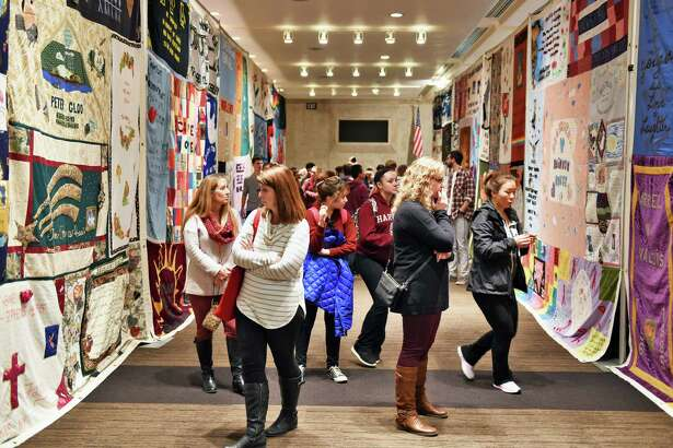 Attendees look over AIDS quilts at World AIDS Day at the Empire State Plaza Convention Center Tuesday Dec. 6, 2016 in Albany, NY.  (John Carl D'Annibale / Times Union)