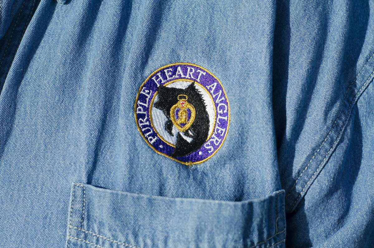 A Purple Heart Anglers badge is seen stitched on to Randy Hudson's shirt during a photo shoot in Half Moon Bay, CA, on Tuesday December 6, 2016.
