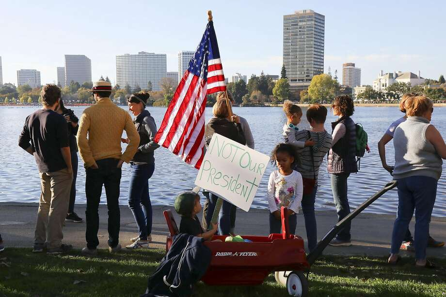 Kaya, 2, and Sai Mattia, 4, with their wagon during a protest of Donald Trump's election as president that organizers called Hands Around Lake Merritt, in Oakland, Calif, Nov. 13, 2016. A similar protest is set to take place on April 29, 2017 Photo: JIM WILSON, NYT