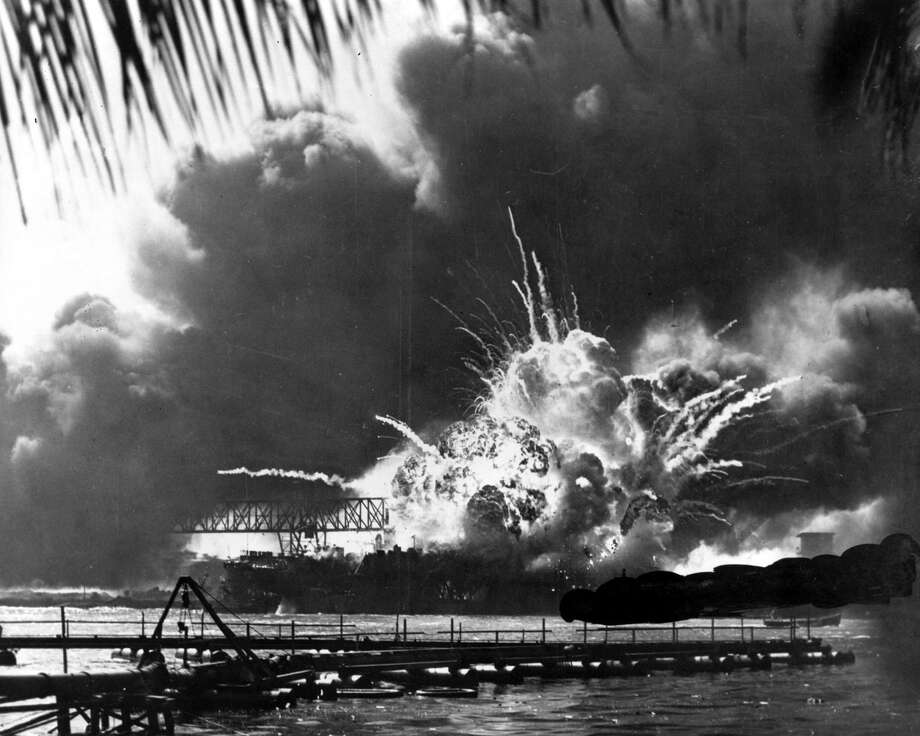 Smoke and flame are seen as the magazine explodes on the destroyer USS Shaw during the Japanese attack on Pearl Harbor, Hawaii, on Dec. 7, 1941. Photo: AP File Photo / AP
