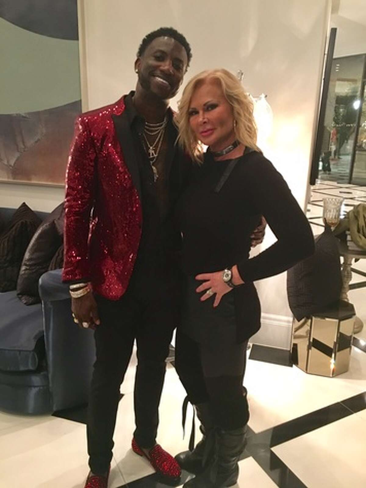 Homeowner Theresa Roemer poses with rapper Gucci Mane. >>Click to see her incredible mansion and its famous closet.