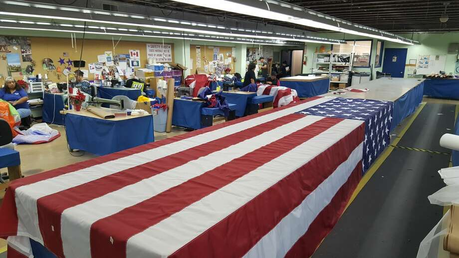 Dixie Flag Manufacturing Company working to finish flags for President-elect Donald Trump's inauguration on Jan. 20, 2017. Photo: Courtesy/Dixie Flag Manufacturing Company