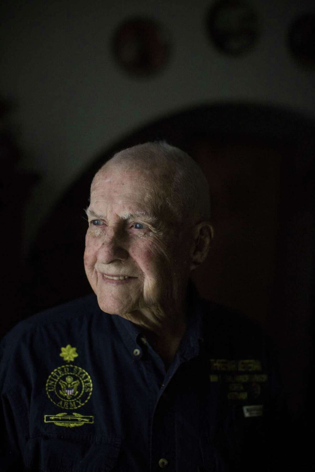Virgil Lee Ward, a 95-year-old veteran who was stationed in Hawaii during the attack on Pearl Harbor, stands for a portrait in his home in San Antonio, Texas on December 1, 2016.