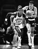 Golden State Warriors forward Purvis Short dribbles down the court in a Nov. 6, 1985 game against the Seattle Supersonics.