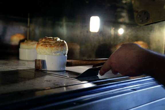 Chef Nicholas Alvis removes a soufflé from the oven at Rise No. 2. Founded by Hedda Gioia Dowd, the first Rise is located in Dallas.