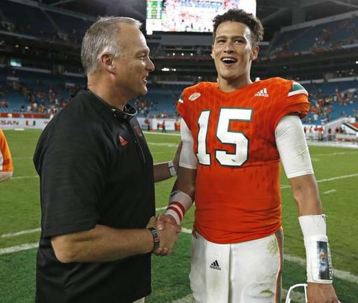 Miami head coach Mark Richt, left, shakes hands with quarterback Brad Kaaya (15) on the field after an NCAA college football game against Duke in Miami Gardens, Fla., Saturday, Nov. 26, 2016. (Al Diaz/Miami Herald via AP)