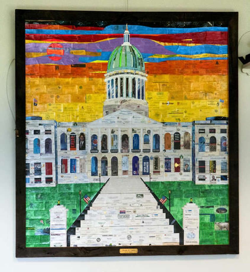 "This Oct. 27, 2016 photo provided by Joe Phelan shows Glenn Adams' ""House of Cards"" which hangs on the wall at the State House in Augusta, Maine. (Joe Phelan via AP)"
