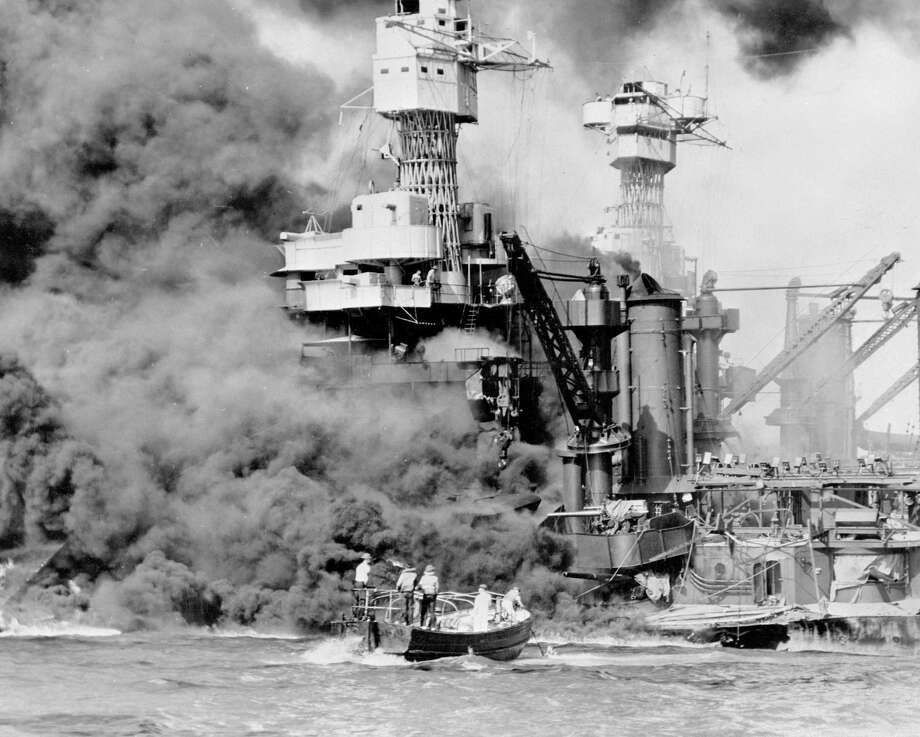 Before the Dec. 7, 1941, attack on Pearl Harbor, many Americans held optimistically to certain beliefs about war and international politics — that dictatorship and aggression in faraway lands did not concern the United States; that alliances were a source of vulnerability rather than strength; that a strong military made war more rather than less likely. Photo: Library Of Congress /Associated Press / U.S. Navy via Library of Congress