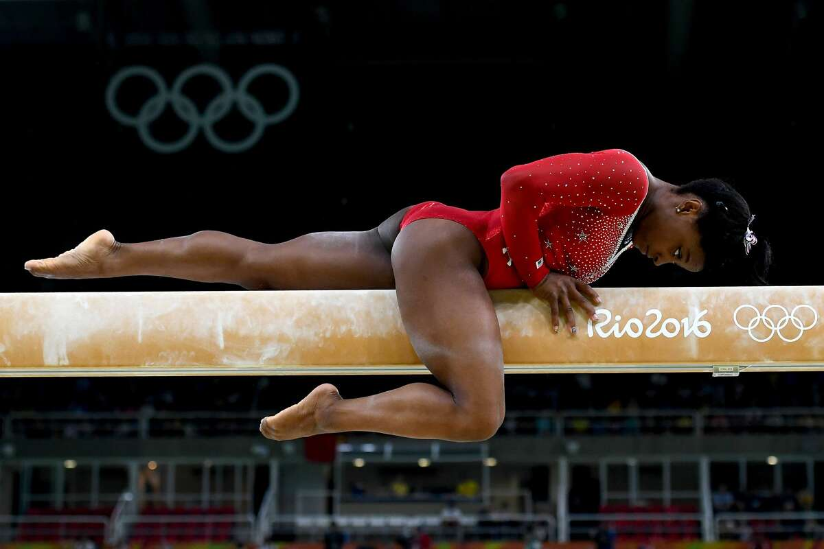 YEAR IN FOCUS - SPORTS (1 of a set of 105) RIO DE JANEIRO, BRAZIL - AUGUST 15: Simone Biles of the United States competes in the Balance Beam Final on day 10 of the Rio 2016 Olympic Games at Rio Olympic Arena on August 15, 2016 in Rio de Janeiro, Brazil. (Photo by Laurence Griffiths/Getty Images)