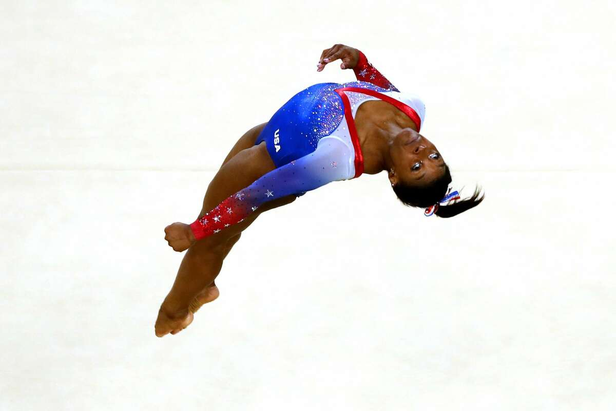 PHOTOS: Getty Images' most iconic sports photos of 2016 YEAR IN FOCUS - SPORTS (1 of a set of 105) RIO DE JANEIRO, BRAZIL - AUGUST 16: Simone Biles of the United States competes on the Women's Floor final on Day 11 of the Rio 2016 Olympic Games at the Rio Olympic Arena on August 16, 2016 in Rio de Janeiro, Brazil. (Photo by Dean Mouhtaropoulos/Getty Images)